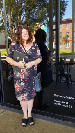 Marion Conrow at the front of the Lismore Gallery, before an informal feedback session, ready with pen and notebook!