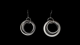 #11 - concentric 3 rings with 1 black, no spring - earrings