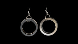 11C - concentric 2 rings, one black one metal - ear rings